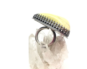 Serpentine ring large yellow ring big ring large stone ring statement ring ring with meaning