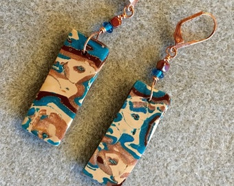 Dramatic polymer clay earrings in an organic teal, brown and copper design