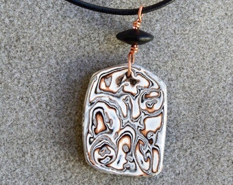 Dramatic polymer clay pendant necklace in an organic black, white and copper design