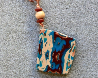 Dramatic polymer clay pendant necklace in an organic teal, brown and copper design
