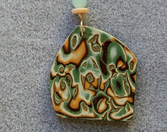 Dramatic polymer clay pendant necklace in an organic green, gold and copper design