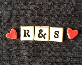 3 letter tiles + 2 red hearts