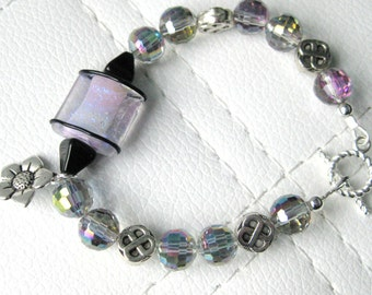 Artisan Lampwork Bead in Purple with Silver Flower Charm and Faceted Glass Beaded Bracelet