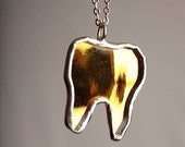 Gold Mirror Tooth Pendant...