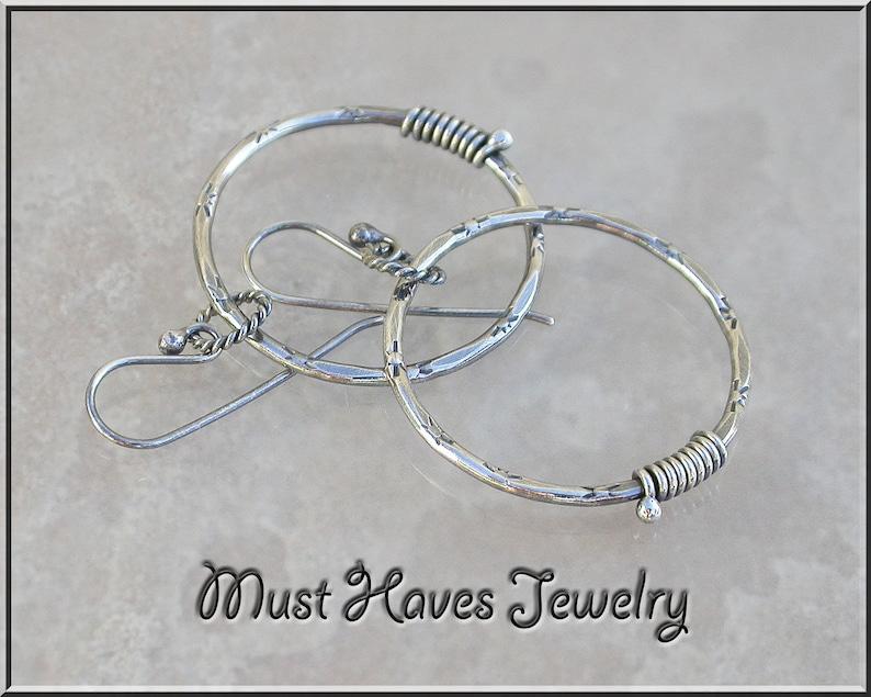 Textured Metalwork silver Hoop Earrings image 0
