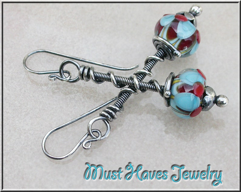 Long twisted Southwest  lampwork  and silver dangle earrings image 0