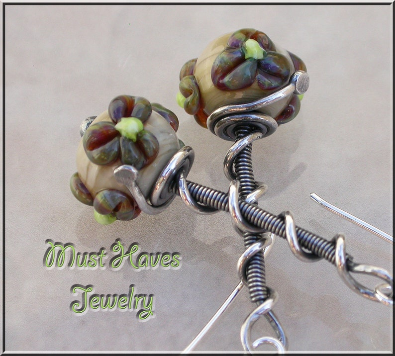 Dainty brown flower lampwork dangle earrings image 0