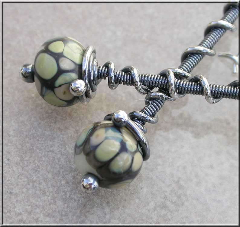 Long twisted Black and beige  lampwork  and silver dangle image 0