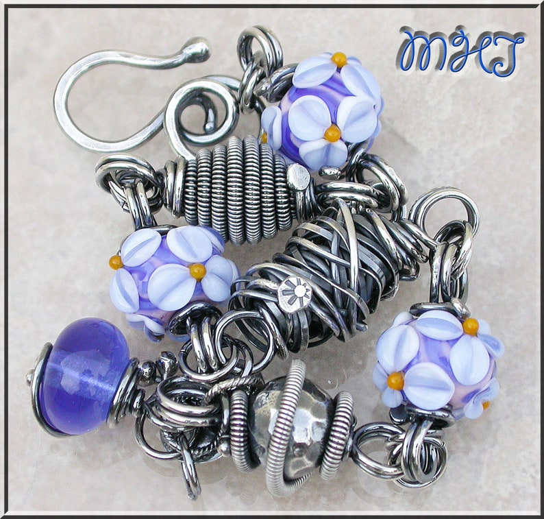 Denim Blue flowers Lampwork and silver wire wrapped link image 0