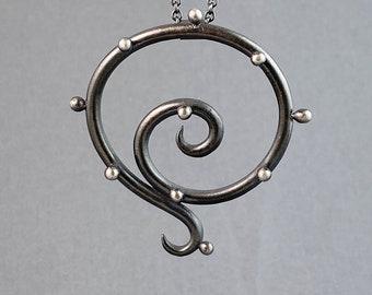 Curvy polka dot oxidized pendant on cable chain