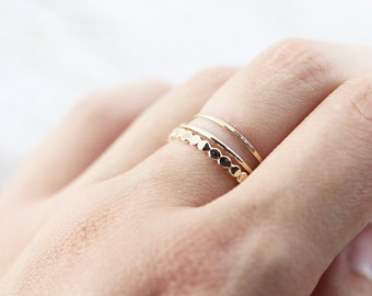 Set of 3 textured rings - large flattened bead, thin smooth and hammered extra thin