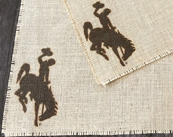 Wyoming bucking horse rider burlap placemats - set of two