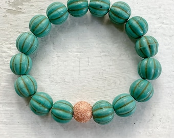 Carved Howlite Turquoise Handmade Stretch Bracelet with Copper Accent