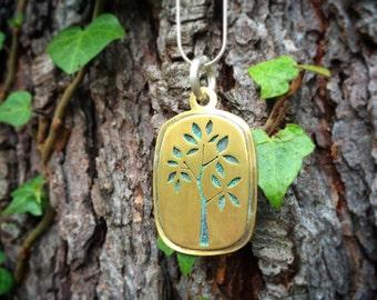 Brass cutout tree necklace