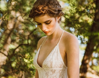 The Crete | by Elika In Love. The perfect beach wedding dress, this low back stretch lace gown is bohomian chic for the free spirited bride.