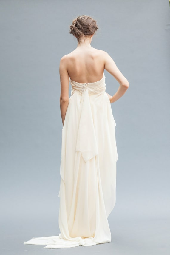 Short Wedding Dress This Backless Wedding Gown Features Luxurious Grecian Draping In Silk Chiffon Ending In A Floor Length Ruffled Train