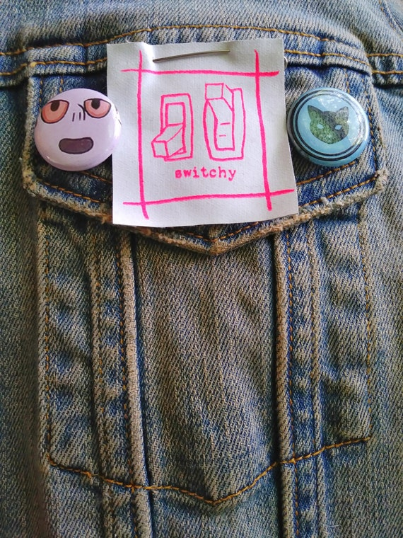 SWITCHY pin pinback button badge perfect for jackets, vests, and more