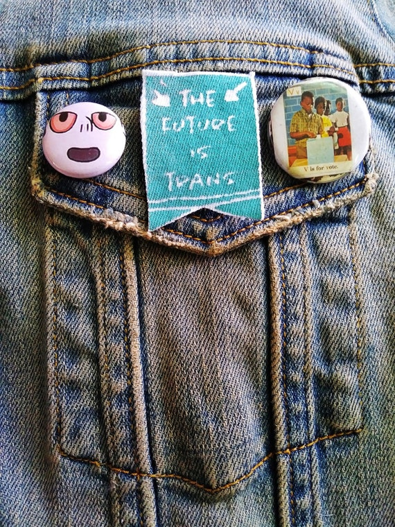 the future is trans pin pinback badge perfect for jackets, vests, and more