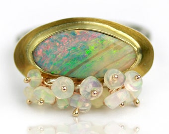 Pastel and Cream Striations Boulder Opal with Welo Clusters Ring. Size 7 1/2 to 8.