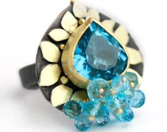 Blue Topaz and Gold Leaves Ring. Size 6 1/4.