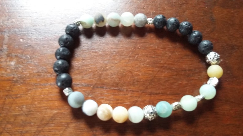 Hope these work to repel ticks. First day of Spring special Lava and Amazonite anklet for essential oils or just plain pretty to wear
