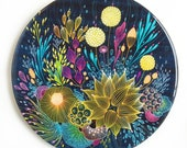 Resin covered print on round panel, Hint