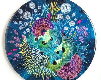 Resin covered print on round panel, Seedling