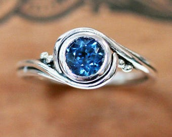 London blue topaz ring silver, alternative engagement ring, swirl ring, bypass ring, recycled silver ring eco friendly ring pirouette custom