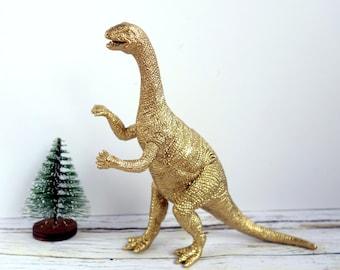 Gold dinosaur figure: dinosaur lover gift or Christmas decoration.