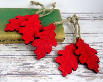 Red oak leaf Christmas decorations, wooden leaf ornaments. Rustic, country, woodland holiday decor.
