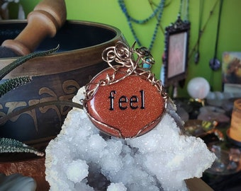 Goldstone  Wirewrapped in  Gold Filled wire with Engraved word Feel