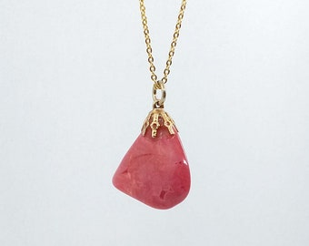 pink stone pendant in gold tone necklace