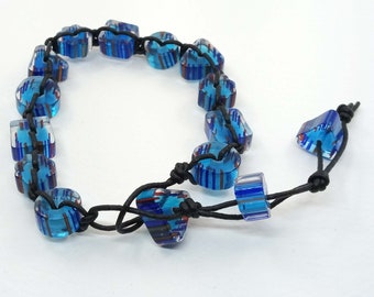 blue cane glass knotted in waxed cord bracelet