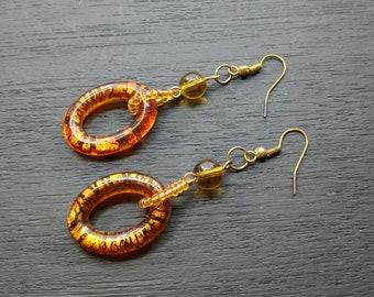 amber acrylic gold tone dangle earrings