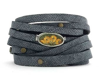 Soft Leather Cuff with sparkly gold sequin Shi piece and antique brass studs.