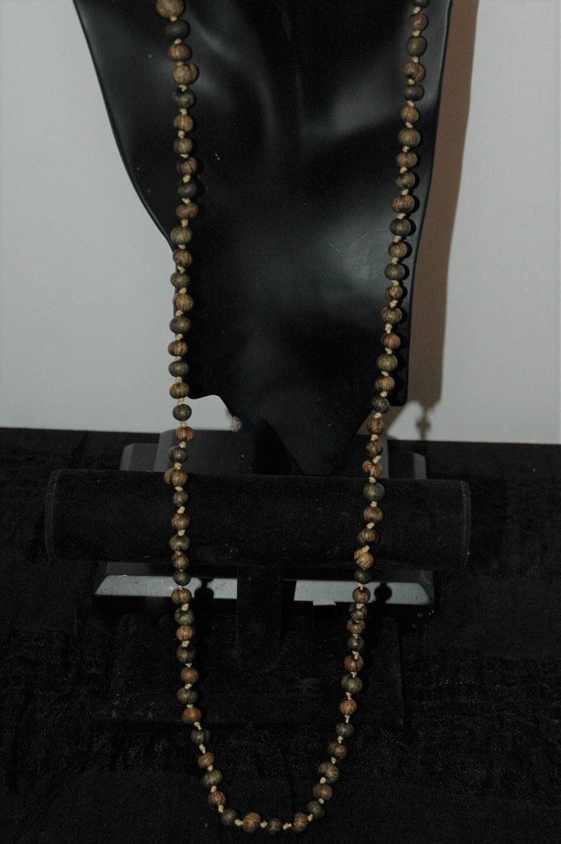 Coldwater Creek knotted natural seed necklace.
