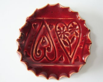 Red ring dish with heart imprints