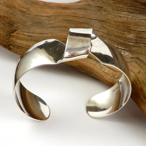 Artistic fold-formed hammered silver-and-gold cuff bracelet.
