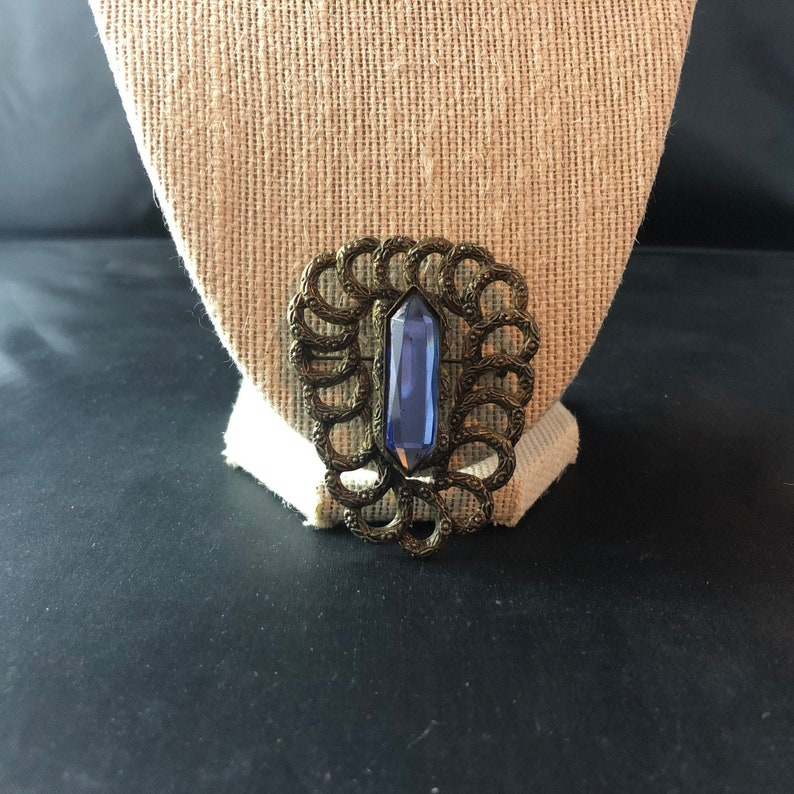 Unique Brooch Pin Upside Down Triangle Dark Gold Brass Looking Metal Tiny Imprinted Flowers Dark Blue Sapphire Colored Rectangular Stone