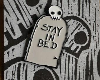 Skeletal Dropkick Stay In Bed soft enamel pin