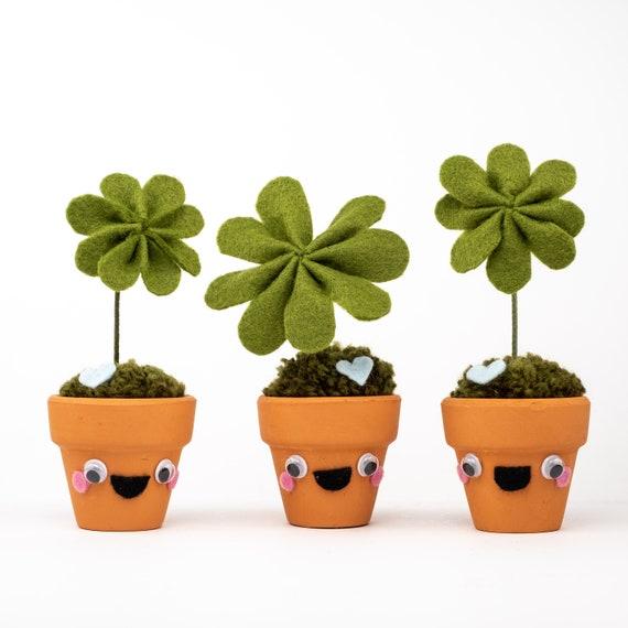 Tiny four leaf clover dude