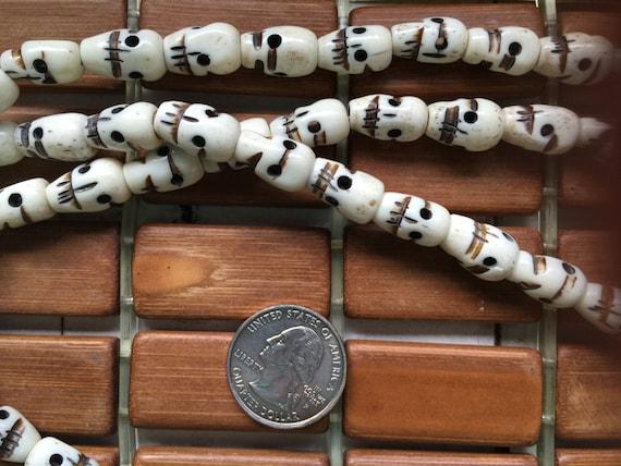 108 carved 8x14mm white bone skull bead mala