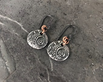 Round Garden Swirl earrings. Calligraphy-style leaf and flower design on silver plated charms and hypoallergenic niobium ear wires