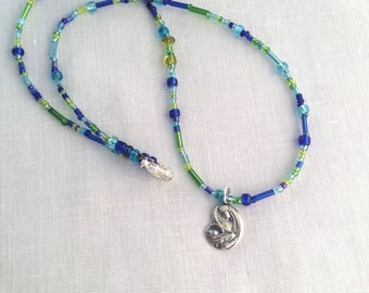 Mother Mary seed bead necklace with sterling silver drop. Blue beads with Our Lady charm