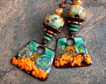 Tropical Garden. Artisan earrings. Bonemian organic design. Lampwork beads, enameled charms, Czech glass. Solid copper. Green orange.