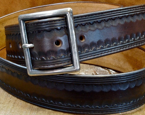 Brown leather belt : Hand Tooled Western border with Distressed buckle. Gun leather/ Cowboy style. Made in New York