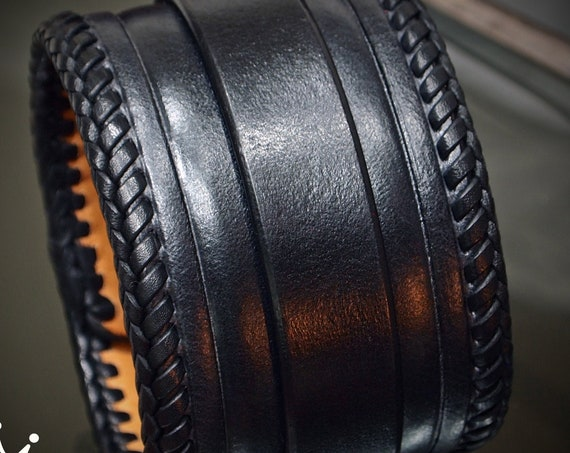 Black Leather Cuff bracelet: Fine craftsmanship- Tooled and laced with leather snaps! Hand made in New York!