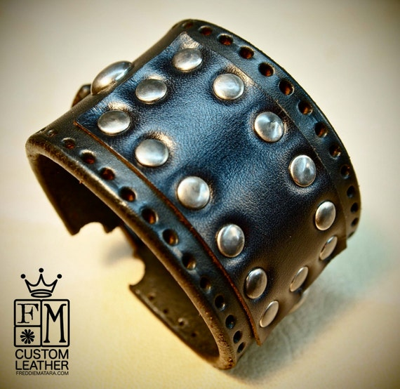 Black bridle leather cuff studded with antique nickel hardware