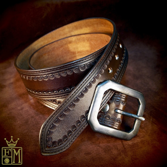 "Brown leather belt :  Tooled Western border with Distressed buckle 1-3/4"" wide. Handmade in USA by Freddie Matara"