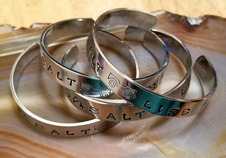 NaCl Life Jeepher Beach Girl hand stamped aluminum cuff bracelet chock full  of shells seahorses dolphins flip flops and so much more